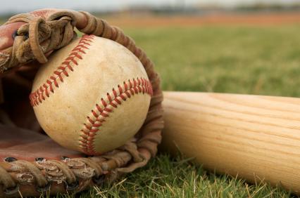Baseball in a Glove near Bat