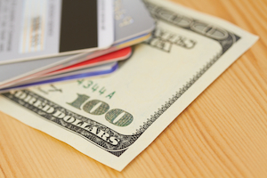 Why do some credit cards charge an annual fee?