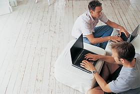 GettyImages-men with laptops on floor