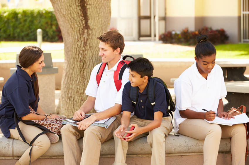 High School Students Hanging Out On School Campus