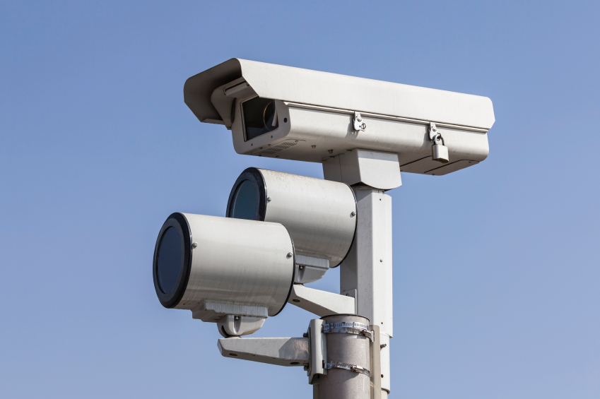 Red-Light Camera Tickets, Safety and Car Insurance Rates