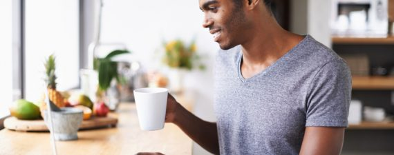 Shot of a young african man enjoying coffee for breakfast