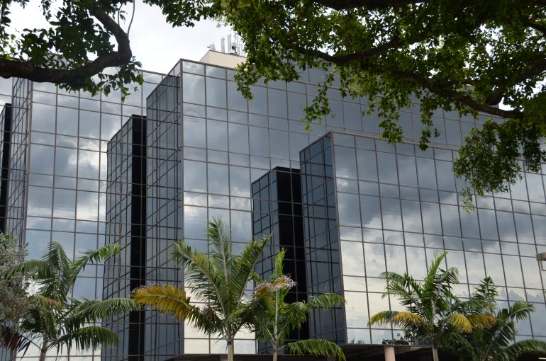 After Consumer Assistance Project LLC was evicted from other quarters, its call center operated from a Coral Gables, Florida, structure known as the Darth Vader building for its hulking black-glass exterior. Credit: Richard Read