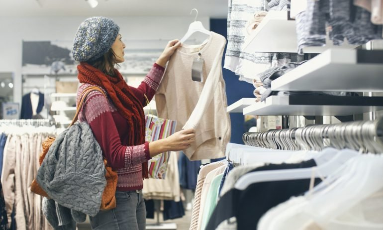 women shopping think credit card