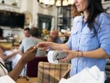 Technology and tipping practices limit the availability of credit card payments at restaurant tables in the U.S.