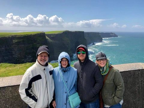 Family picture at the Cliffs of Moher: (left to right) Kenley's parents (Colin and Loril Young), Kenley and his wife (Shelley Young).