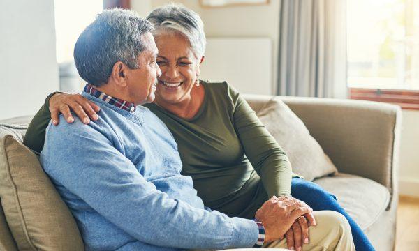 Older couple talking on sofa