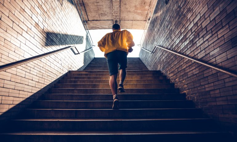 Man jogging up stairwell