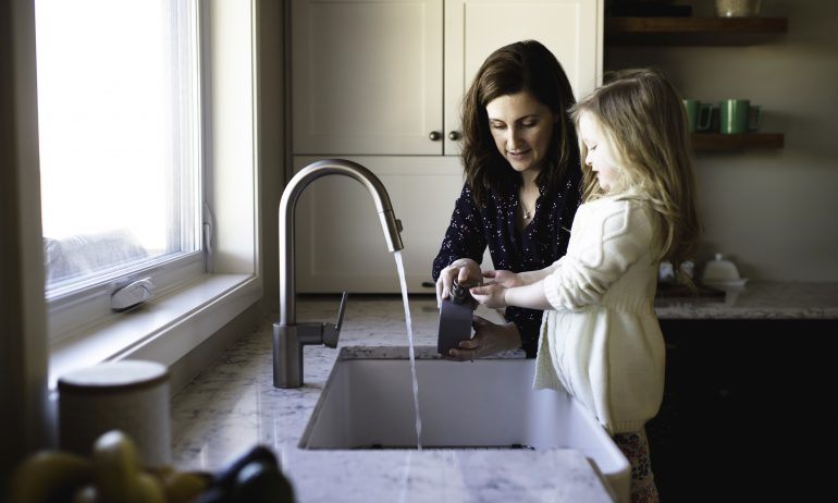 mother-helping-little-daughter-wash-hands