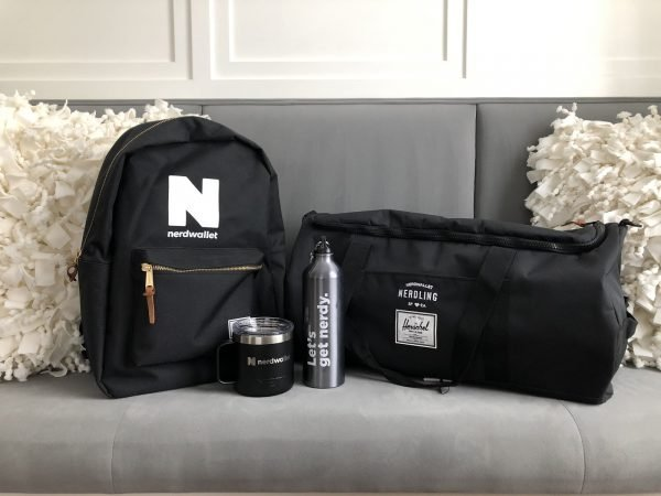 Nerdwallet black backpacket, duffel bag, mug, and water container.