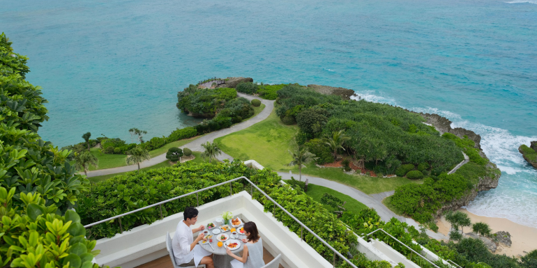 The Club Intercontinental Deluxe Corner Suite at the Intercontinental Manza Beach Resort in Okinawa, Japan offers a spacious outside terrace with 180-degrees of ocean views
