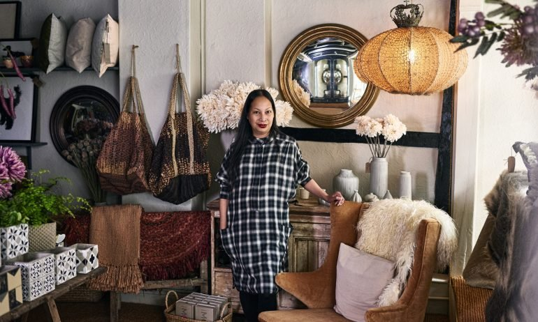 Portrait of female owner in boutique