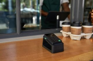 The PayPal Zettle card reader sits on a coffee shop counter